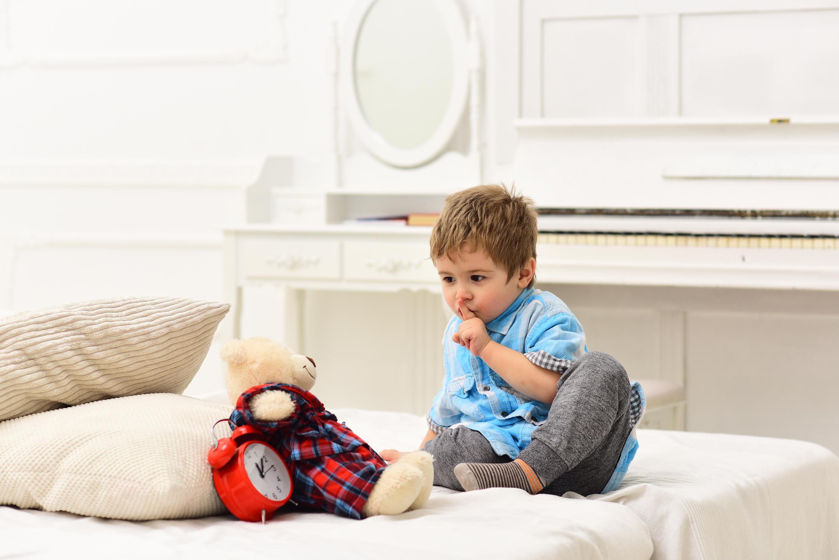 bigstock-Baby-Playing-Bear-Playing-On-W-235754236.jpg